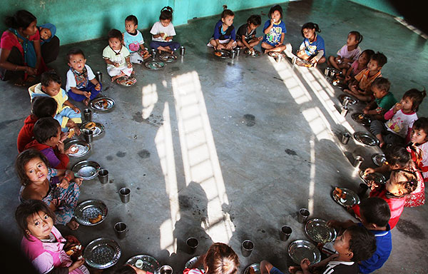 CWON Australia childcare project - young kids sitting in a circle about to eat